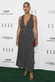 Tracee Ellis Ross amped up the allure with this plunging gray midi dress at the Elle Women in Hollywood Awards.