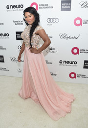 Lil Kim showed her demure side in a blush-colored Mac Duggal gown with a beaded bodice and a flowy skirt during Elton John's Oscar-viewing party.