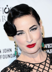 Dita Von Teese finished off her eye-catching beauty look with a glossy red lip.