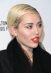 Miley Cyrus has a tattoo of the word 'LOVE' sitting just beside those hoops.