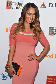 A blue and orange hard-case clutch finished off La La Anthony's ensemble in modern style when she attended the GLAAD Media Awards.