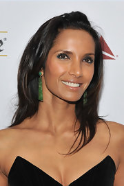 For her hairstyle, Padma Lakshmi opted for bouncy layers with pinned-back bangs.