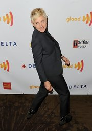 Ellen DeGeneres got campy on the red carpet in this charcoal suit.