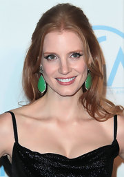 Jessica Chastain's massive Bochic jade earrings added a welcome pop of color to her black gown.