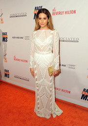 Ashley Tisdale flashed her undies in a sheer white crochet gown by Balmain at the Race to Erase MS Gala.