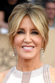 Felicity Huffman went '60s-chic with this beehive at the SAG Awards.