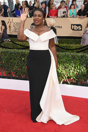 Uzo Aduba kept it timeless at the SAG Awards in a black-and-white Elizabeth Kennedy off-the-shoulder gown with an attached train.