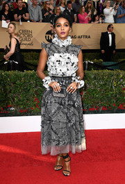 Janelle Monae made an ultra-chic statement at the SAG Awards in a monochrome Chanel print dress with a flower-appliqued bodice and neckline.