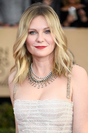 Kirsten Dunst went for an ultra-luxe finish with a trio of diamond statement necklaces by Fred Leighton.