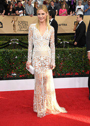 Julie Bowen paired her sexy gown with a white hard-case clutch by Tyler Ellis.