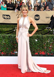Felicity Huffman chose a white Antonio Grimaldi Couture fishtail gown with silver trim for her SAG Awards red carpet look.