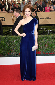 Ellie Kemper stepped up the elegance with a silver glitter clutch by Judith Leiber.