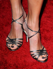 Stacy Keibler went with a pair of strappy silver heels to go with her pink strapless dress.