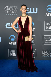 Emmy Rossum paired her dress with a gold clutch by Bulgari.