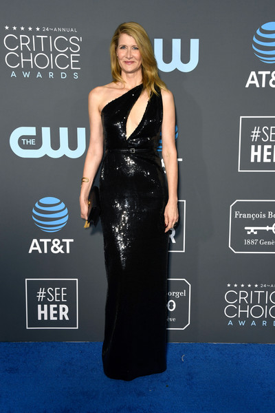 Laura Dern looked sassy in a black one-shoulder cutout gown by Saint Laurent at the 2019 Critics' Choice Awards.