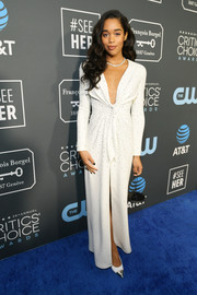 Laura Harrier looked sophisticated in a plunging white gown by Louis Vuitton at the 2019 Critics' Choice Awards.