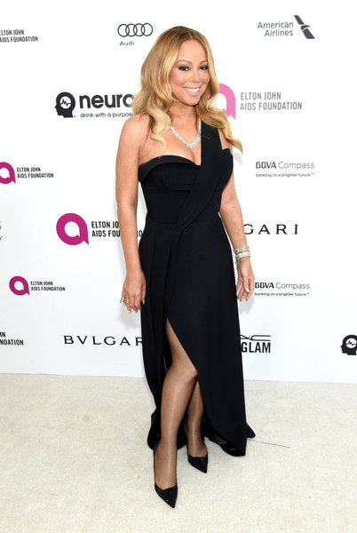 Mariah Carey sported a classic silhouette in this black one-shoulder gown during the Elton John AIDS Foundation Oscar viewing party.