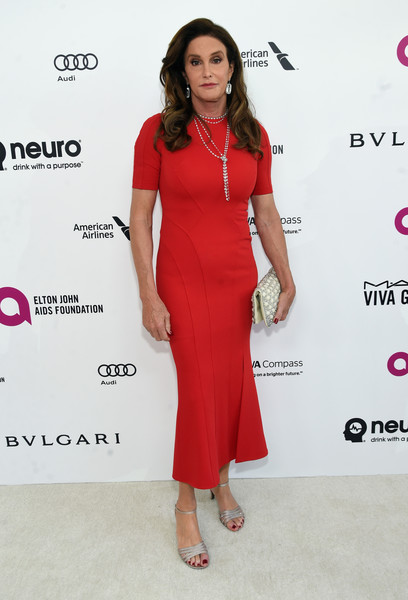 Caitlyn Jenner made an appearance at the Elton John AIDS Foundation Oscar viewing party wearing a form-fitting red dress by Zac Posen.