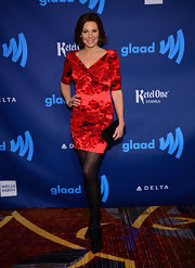 LuAnn de Lesseps opted for a red floral-print dress for her elegant red carpet look.
