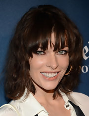 Milla Jovovich opted for a natural crimped wave and thick bangs for her red carpet 'do at the GLAAD Awards.