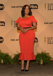 Niecy Nash charmed in a red off-the-shoulder dress with a fluted hem at the SAG Awards nominations announcement.