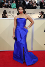 Susan Kelechi Watson looked gorgeous on the red carpet in a strapless electric-blue gown by Rubin Singer at the 2018 SAG Awards.