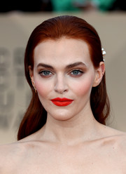 Madeline Brewer contrasted her neutral eye makeup with a bright red lip.
