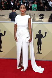 Tracee Ellis Ross polished off her monochromatic look with a white satin clutch by Jimmy Choo.