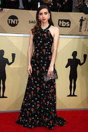 Zoe Kazan finished off her look with a crystal-studded satin clutch.
