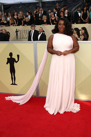 Uzo Aduba looked simply divine in a pink Christian Siriano one-shoulder gown with a watteau train at the 2018 SAG Awards.