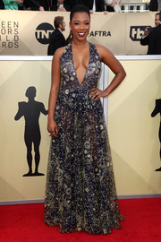 Samira Wiley went for sexy glamour in a semi-sheer, intricately embroidered navy gown by Tadashi Shoji at the 2018 SAG Awards.