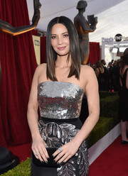 Olivia Munn arrived for the 2018 SAG Awards carrying a classic black satin clutch by Tyler Ellis.