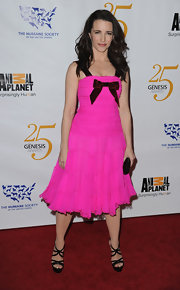 Kristin adds a pop of color to the Genesis Awards in a hot pink chiffon frock with a velvet bow.