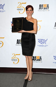 Carrie wore a one-shoulder LBD with a satin ruffle to the Genesis Awards in LA.