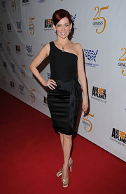 Carrie Preston accented her sleek black satin dress with gold satin peep toe pumps.