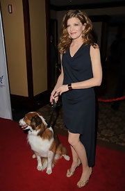 Rene wears a lovely navy knit cocktail dress to the Humane Society Genesis Awards.