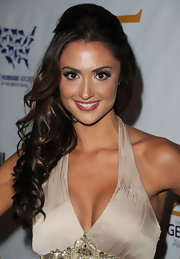Katie Cleary brought her haltered neckline to the forefront with a curled half up hairstyle complete with a volume at the crown.