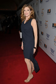 Rene Russo paired her navy blue dress with delicate gold braided sandals.