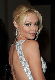 Charlotte Ross gave her elegant look an edgy touch with chain embellished earrings.