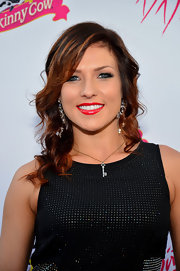 Here Sharna Burgess wears her long locks in beachy waves.