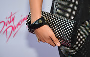 Professional ballroom dancer Sharna Burgess carried a gun metal studded clutch to the  'Dirty Dancing'premiere.