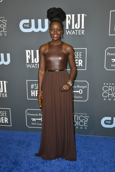Lupita Nyong'o kept it fuss-free in a brown racer-neckline gown by Michael Kors at the 2020 Critics' Choice Awards.
