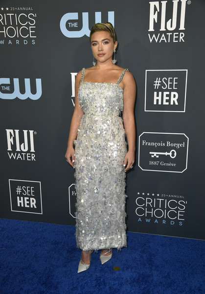Florence Pugh polished off her look with a pair of embellished ivory pumps by Jimmy Choo.