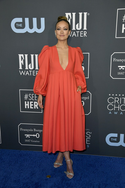 Olivia Wilde styled her frock with silver evening sandals by Jimmy Choo.