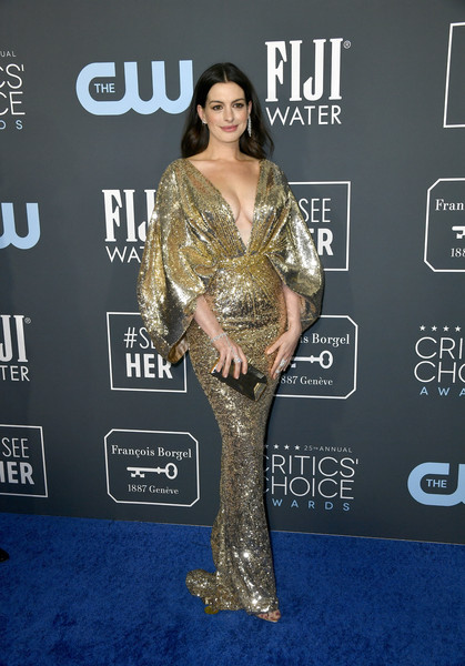 Anne Hathaway looked spectacular in a gold sequined gown with a plunging neckline and cape sleeves at the 2020 Critics' Choice Awards.