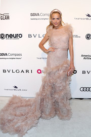 Petra Nemcova went extra frothy in a flower-appliqued fishtail gown at the Elton John AIDS Foundation Oscar-viewing party.