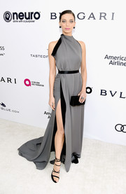Angela Sarafyan looked super sophisticated at the Elton John AIDS Foundation Oscar-viewing party in a gray and black August Getty Atelier halter gown with a high slit and an open back.