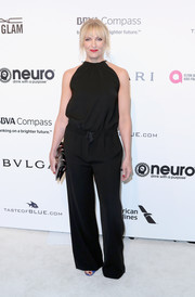 Toni Collette was casual yet stylish in a sleeveless black jumpsuit at the Elton John AIDS Foundation Oscar-viewing party.
