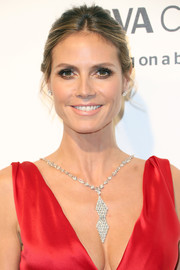 Heidi Klum attended the Elton John AIDS Foundation Oscar-viewing party wearing her hair in a casual bun.