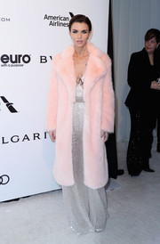 Ruby Rose oozed glamour at the Elton John AIDS Foundation Oscar-viewing party wearing a pink fur coat over a metallic gown.